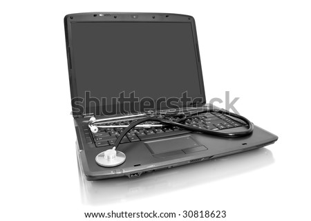 medicine technology;  laptop with stethoscope isolated on white