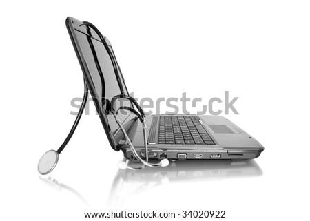 medicine technology. laptop with stethoscope isolated on white - stock photo