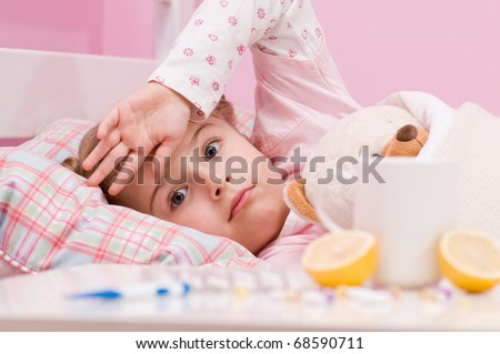 Medicines and hot tea in front, sick girl with teddy bear in bed ( No-name teddy bear ) - stock photo