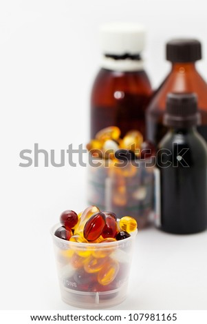 Medicines, capsules and pills, bottles - stock photo