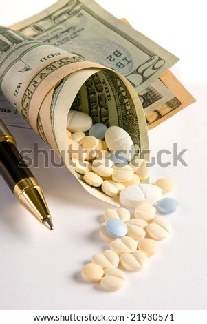 Medicines coming out of a roll of dollar notes