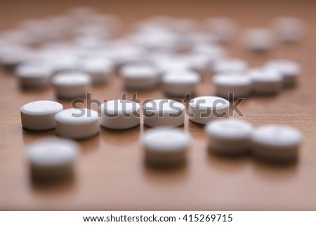 Medicines on wood background