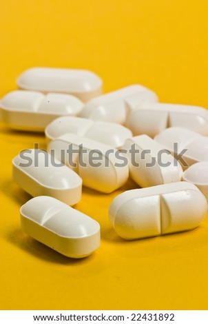medicines on yellow background