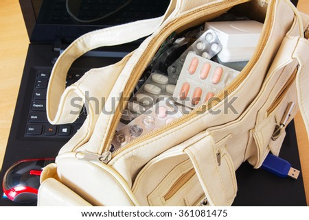 Medicines, Tablets, Capsules and Empty Blister in Women Handbag. - stock photo