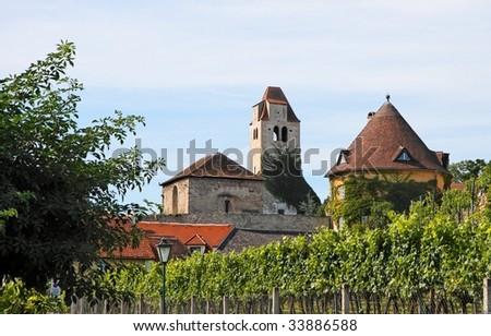 Medieval abbey among vineyards in Durnstein, Austria - stock photo