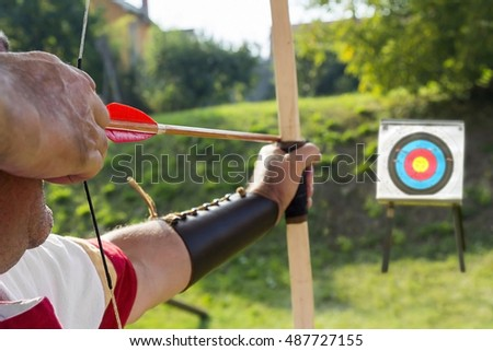 Medieval archer to use a bow and arrow and shoot at a target
