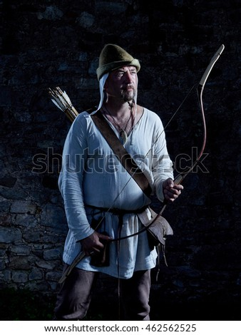 Medieval archer with a bow and arrows