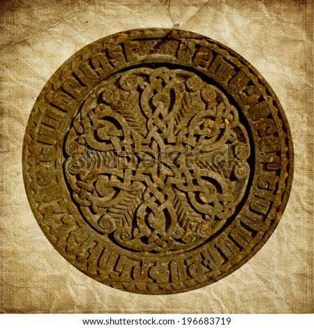 Medieval Armenian ornament on cross stone in grunge style isolated on old paper background - stock photo