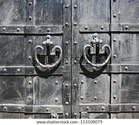 Medieval black wrought-iron gates - stock photo