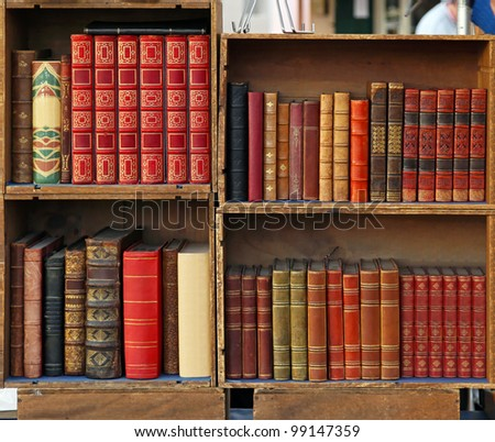 Medieval books in wooden bookcases - stock photo