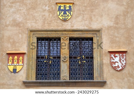 Medieval building detail with highly decorated window on the streets of Prague Old Town, Czech Republic - stock photo