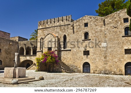 Medieval buildings at the Argirokastrou Square in the old town of Rhodes, Greece. - stock photo