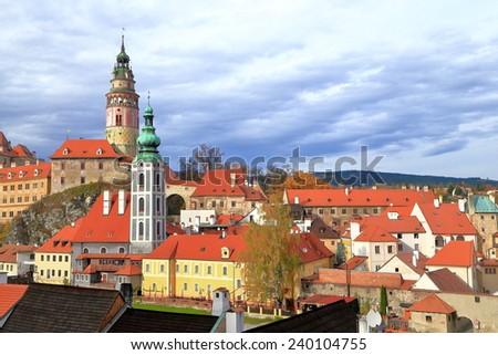 Medieval buildings lit by autumn sun under overcast sky, Cesky Krumlov, Czech Republic - stock photo