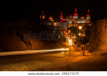 Medieval castle at night. View of a beautiful castle at night. - stock photo