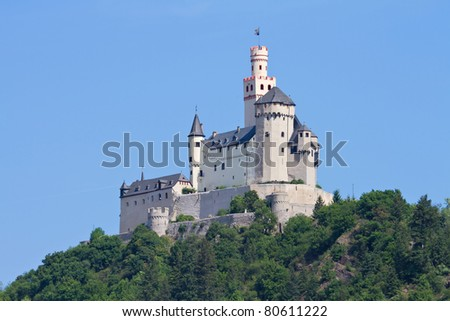Medieval castle Marksburg on a hill over the river Rhine, Rhineland Palatine, Braubach, Germany - stock photo