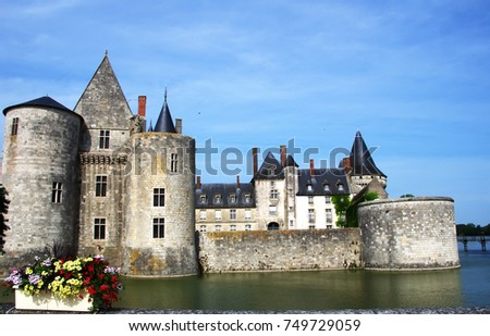 medieval castle Sully-sul-Loire. famous Loire valley river, France