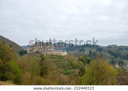 Medieval Castle Vianden, build on top of the mountain in cloudy weather. Luxembourg - stock photo