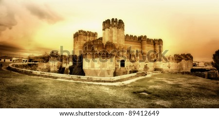 medieval castles of Spain - Coca castle, artistic toned picture - stock photo