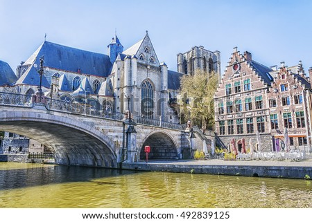 Medieval cathedral and bridge over a canal in Ghent, Belgium