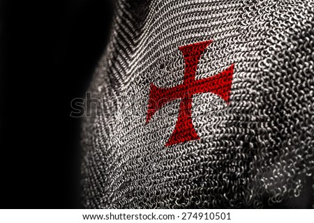 Medieval chainmail armour with a red cross on chest area - stock photo