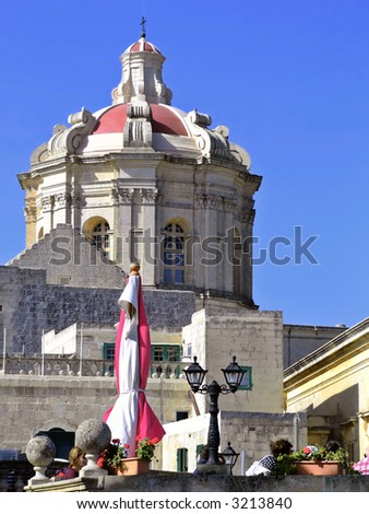 Medieval church dome in the silent medieval city of Mdina, Malta - stock photo