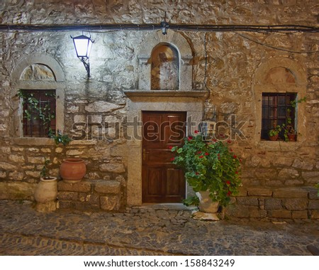 medieval church entrance, night at Chios island, Greece
