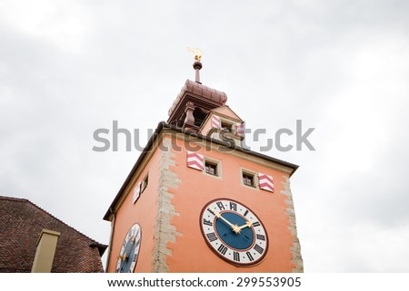medieval church steeple with church clock in Regensburg, Germany - stock photo