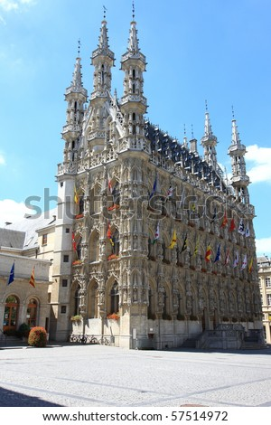 Medieval city hall in Leuven with blue sky - stock photo