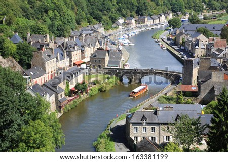 Medieval city of Dinan and its gothic bridge on the Rance, Brittany, France - stock photo