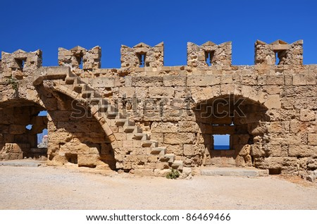 Medieval city walls in Rhodes town - stock photo
