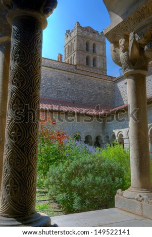 Medieval cloisters at Elne, in Languedoc Roussillon - stock photo