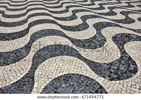 Medieval cobbled square in wave design, Portugal.