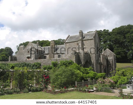 Medieval Compton Castle in Devon, England. Used as a location to film Sense and Sensibility. - stock photo