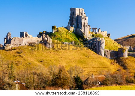 Medieval Corfe Castle in the village of the same name on the Isle Of Purbeck Dorset England UK Europe - stock photo