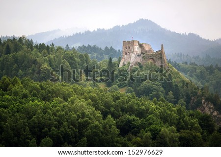 Medieval Czorsztyn castle at the lake in Poland - stock photo