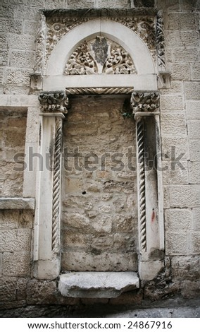 Medieval door to nowhere - stock photo