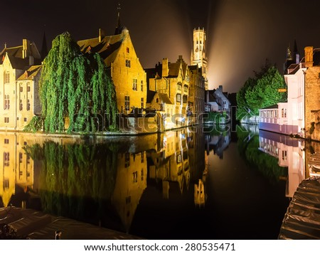 Medieval european city Brugge in lights by night  reflected in the water - stock photo