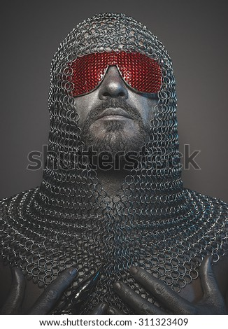 medieval executioner mesh iron rings on the head - stock photo