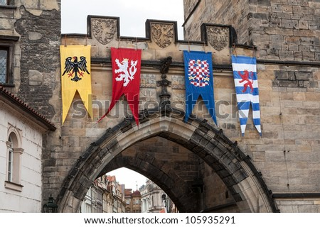 Medieval flags of Old Town bridge tower, Charles bridge, Prague - stock photo