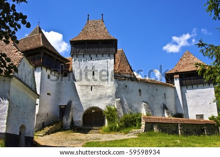 Medieval Fortified church in the village of Viscri, Transylvania, Romania, built around 1100 AD by saxon settlers. - stock photo