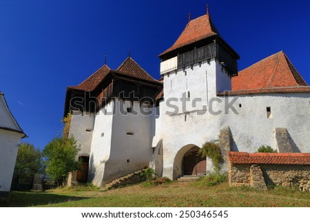 Medieval fortified church listed on UNESCO world heritage in Viscri village, Transylvania, Romania - stock photo