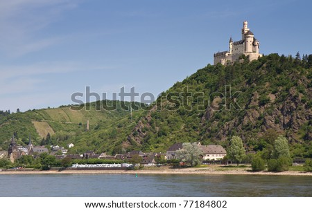 Medieval fortress Marksburg on a hill over the river Rhine, Rhineland Palatine, Braubach, Germany - stock photo
