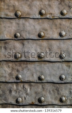 Medieval Fortress Metal Armored Gate Entrance Heavy Door Detail - stock photo
