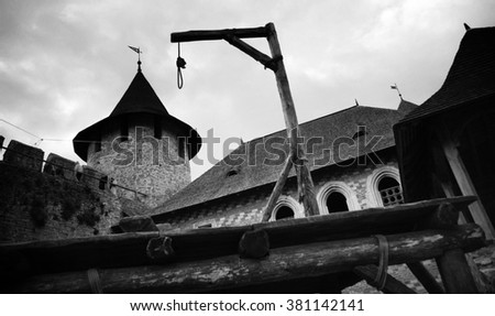 Medieval gallows on the background of a medieval castle - stock photo