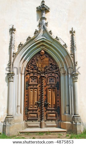 Medieval gothic portal with heraldry carving