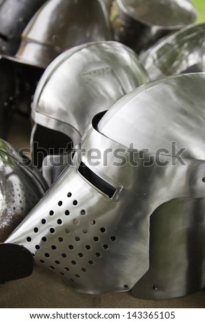 Medieval Helmets, detail of a ancient metal armor of medieval warfare - stock photo