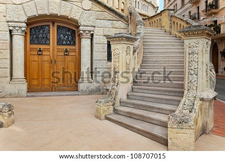 Medieval house entrance with big stone stairs