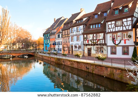 Medieval houses and canal in Colmar, France. Horizontal shot - stock photo