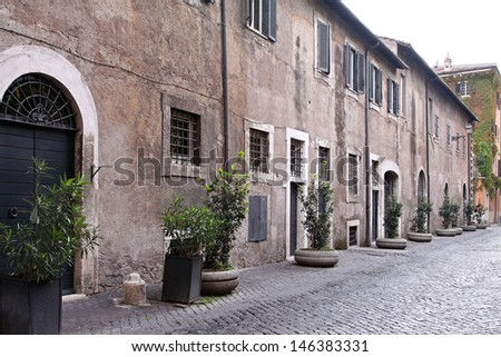 Medieval houses and cobblestone street in old Rome - stock photo