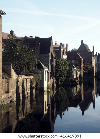 medieval houses on canal historic Bruges Brugge Belgium Europe - stock photo